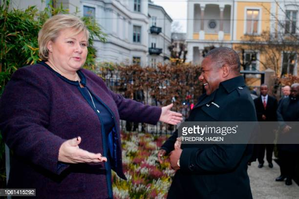 Norway's Prime Minister Erna Solberg welcomes Mozambique's President Filipe Nyusi in Oslo, November 14, 2018. / Norway OUT