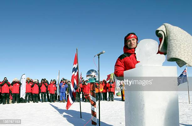 Norway`s Prime Minister Jens Stoltenberg unveils an ice sculpture of polar explorer Roald Amundsen at the South Pole on December 14 2011 Amundsen and...