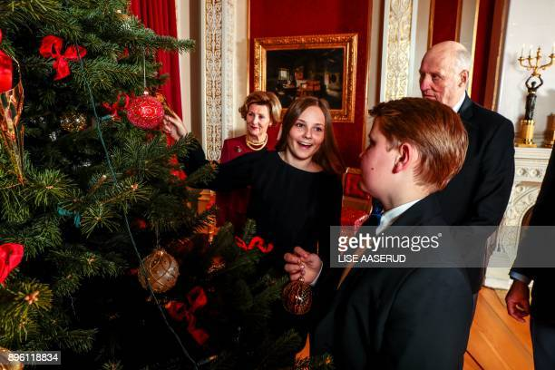 Norway's Prince Sverre Magnus Princess Ingrid Alexandra and their grandparents King Harald and Queen Sonja of decorate a Christmas tree during a...