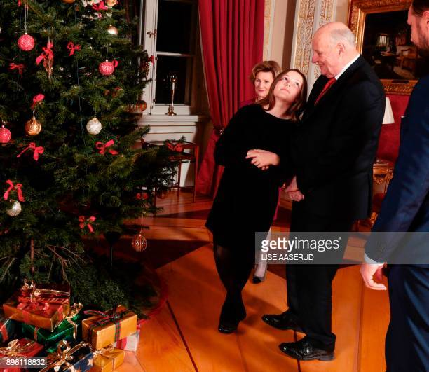 Norway's Princess Ingrid Alexandra stand next to her grandparents King Harald and Queen Sonja of during a Christmas photo session at the Royal Palace...