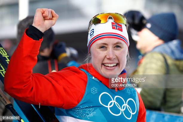 TOPSHOT Norway's Ragnhild Haga celebrates winning gold at the end of the women's 10km freestyle crosscountry competition at the Alpensia cross...