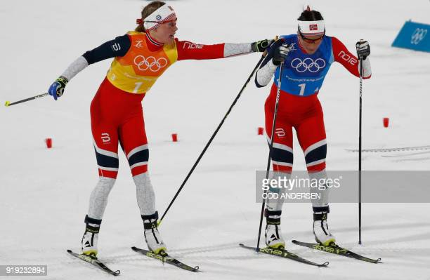 Norway's Ragnhild Haga hands over to Norway's Marit Bjorgen during the women's 4x5km classic free style cross country relay at the Alpensia cross...