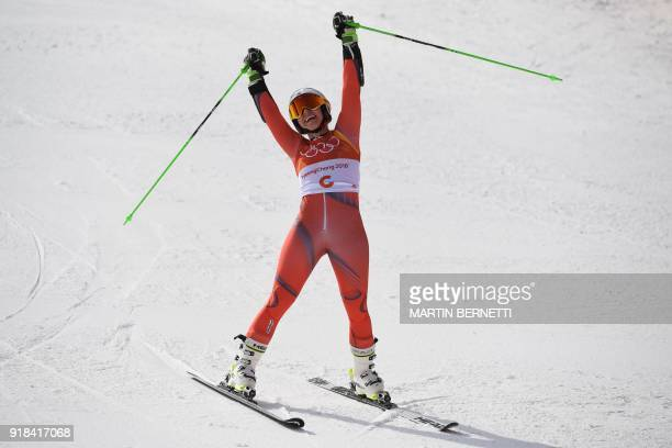 TOPSHOT Norway's Ragnhild Mowinckel reacts as she crosses the finish line to win silver in the Women's Giant Slalom at the Yongpyong Alpine Centre...