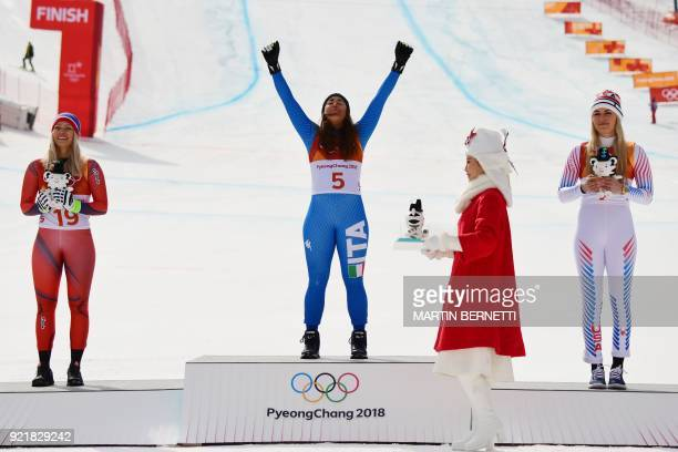 TOPSHOT Norway's Ragnhild Mowinckel second placed Italy's Sofia Goggia winner and USA's Lindsey Vonn third celebrate during the victory ceremony of...