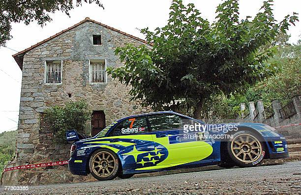 Norway's rally driver Petter Solberg and his British navigator Phil Mills steer their Subaru Impreza WRC during the 51th rally of Corsica 13th round...