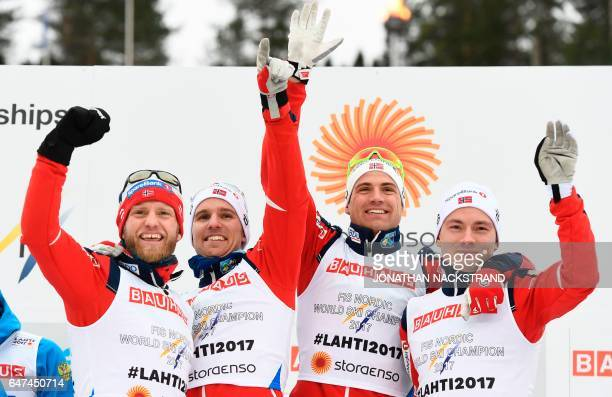 Norway's relay team Martin Johnsrud Sundby, Niklas Dyrhaug, Finn Haagen Krogh and Didrik Tonseth celebrate winning the men's cross-country 4x10 km...