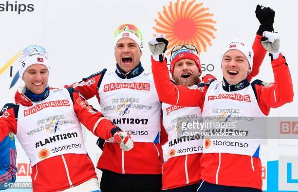 Norway's relay team Niklas Dyrhaug, Finn Haagen Krogh, Martin Johnsrud Sundby and Didrik Tonseth celebrate winning the men's cross-country 4x10 km...