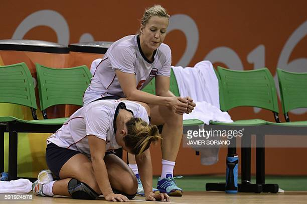 Norway's right back Nora Mork and Norway's pivot Heidi Loke react after being defeated by Russian at the end of the women's semifinal handball match...