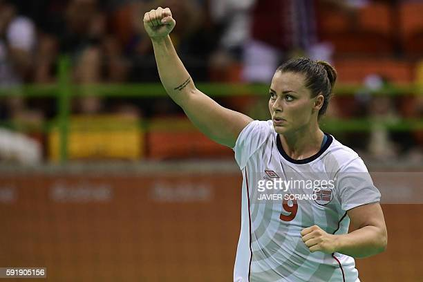 Norway's right back Nora Mork celebrates a goal during the women's semifinal handball match Norway vs Russia for the Rio 2016 Olympics Games at the...