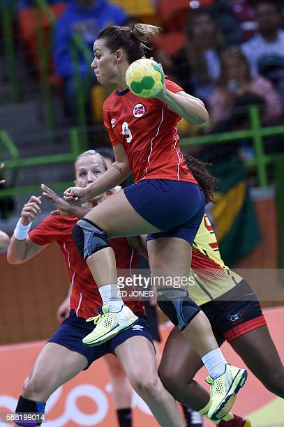 Norway's right back Nora Mork jumps to shoot during the women's preliminaries Group A handball match Norway vs Angola for the Rio 2016 Olympics Games...