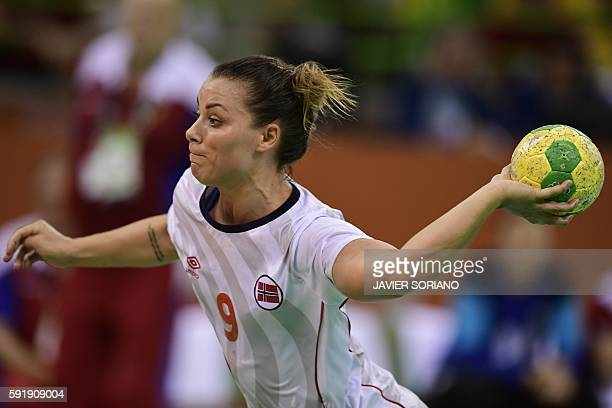 Norway's right back Nora Mork prepares to take a 7meter throw out during the women's semifinal handball match Norway vs Russia for the Rio 2016...