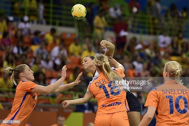 Norway's right back Nora Mork shoots past Netherlands' centre back Nycke Groot , Netherlands' left back Kelly Dulfer and Netherlands' pivot Danick...