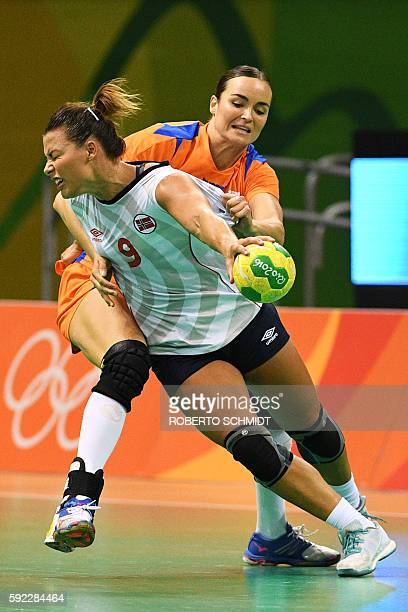 Norway's right back Nora Mork vies with Netherlands' pivot Yvette Broch during the women's Bronze Medal handball match Netherlands vs Norway for the...