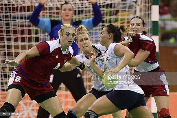 Norway's right back Nora Mork vies with Russia's right back Anna Sen during the women's semifinal handball match Norway vs Russia for the Rio 2016...