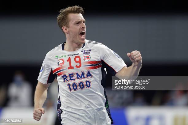 Norway's right winger Kristian Bjornsen celebrates after scoring during the 2021 World Men's Handball Championship between Group III teams Portugal...