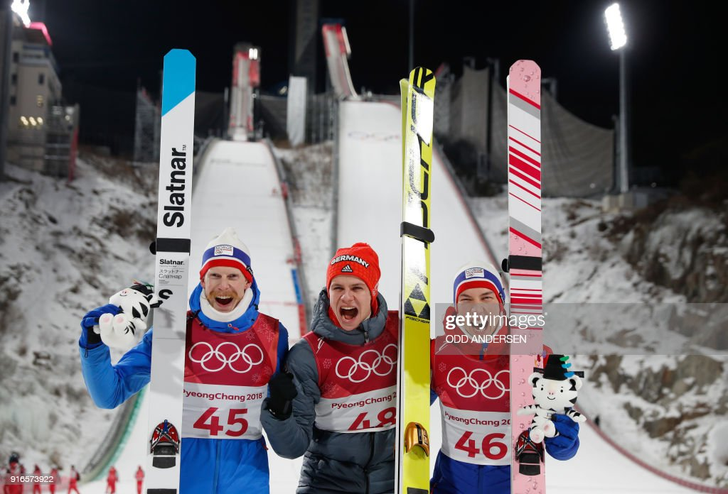 Norway's Robert Johansson, Germany's Andreas Wellinger and Norway's Johann Andre Forfang celebrate during the victory ceremony at the end of the men's normal hill individual ski jumping event during the Pyeongchang 2018 Winter Olympic Games on February 10, 2018, in Pyeongchang. / AFP PHOTO / Odd ANDERSEN