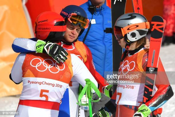 TOPSHOT Norway's second place winner Henrik Kristoffersen Austria's winner Marcel Hirscher and France's third place Alexis Pinturault celebrate after...