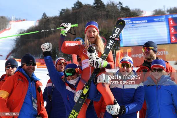 Norway's second place winner Ragnhild Mowinckel celebrates with her team after the women's Giant Slalom at the Yongpyong Alpine Centre during the...