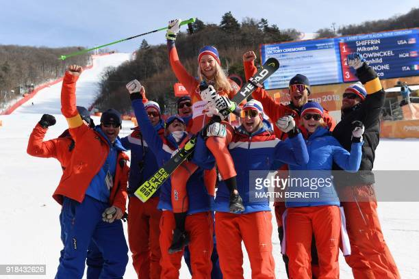 TOPSHOT Norway's second place winner Ragnhild Mowinckel celebrates with her team after the women's Giant Slalom at the Yongpyong Alpine Centre during...