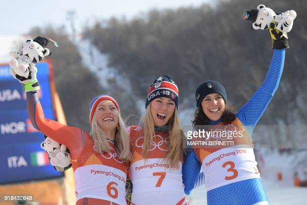 Norway's second place winner Ragnhild Mowinckel USA's winner Mikaela Shiffrin and Italy's third place Federica Brignone pose on the podium during the...