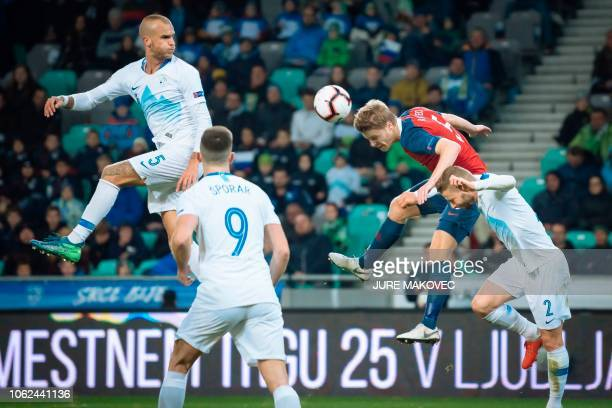 Norway's Sigurd Rosted vies for the ball with Slovenia's Aljaz Struna Andraz Sporar and Nejc Skubic during a UEFA Nations League football match...