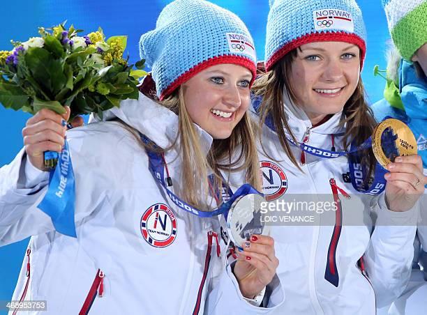 Norway's silver medalist Ingvild Flugstad Oestberd and Norway's gold medalist Maiken Caspersen Falla pose during the Women's CrossCountry Skiing 10km...
