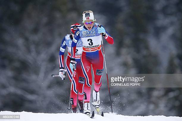 Norway's Silver medalist Therese Johaug and bronze medalist Heidi Weng compete in the World Cup Cross Country women's 10 km Classic Pursuit at...