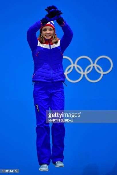 Norway's silver medallist Maiken Caspersen Falla jumps on the podium during the medal ceremony for the women's cross country sprint classic at the...