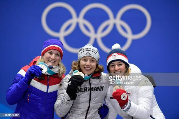 Norway's silver medallist Marte Olsbu, Germany's gold medallist Laura Dahlmeier and Czech Republic's bronze medallist Veronika Vitkova pose on the...