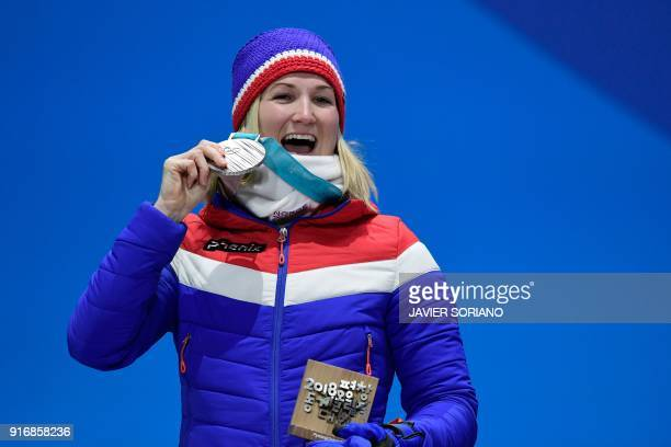 Norway's silver medallist Marte Olsbu poses on the podium during the medal ceremony for the biathlon Women's 75km Sprint at the Pyeongchang Medals...