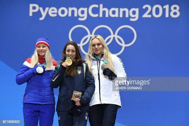 Norway's silver medallist Ragnhild Mowinckel, Italy's gold medallist Sofia Goggia and USA's bronze medallist Lindsey Vonn pose on the podium during...