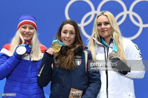 Norway's silver medallist Ragnhild Mowinckel Italy's gold medallist Sofia Goggia and USA's bronze medallist Lindsey Vonn pose on the podium during...