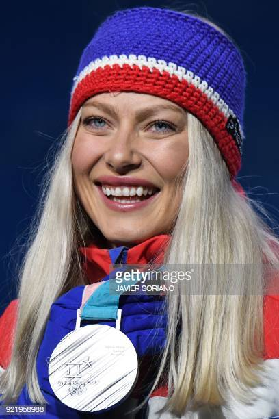 Norway's silver medallist Ragnhild Mowinckel poses on the podium during the medal ceremony for the alpine skiing Women's Downhill at the Pyeongchang...