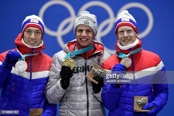 Norway's silver medallist Robert Johansson Germany's gold medallist Andreas Wellinger and Norway's bronze medallist Johann Andre Forfang pose on the...