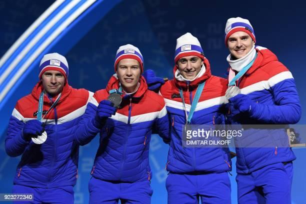 Norway's silver medallists Joergen Graabak Jarl Magnus Riiber Espen Andersen and Jan Schmid pose on the podium during the medal ceremony for the...