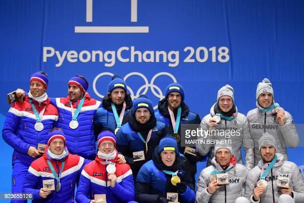Norway's silver medallists Lars Helge Birkeland Tarjei Boe Johannes Thingnes Boe and Emil Hegle Svendsen Sweden's gold medallists Peppe Femling...