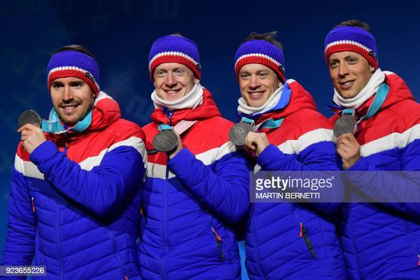 TOPSHOT Norway's silver medallists Lars Helge Birkeland Tarjei Boe Johannes Thingnes Boe and Emil Hegle Svendsen pose on the podium during the medal...