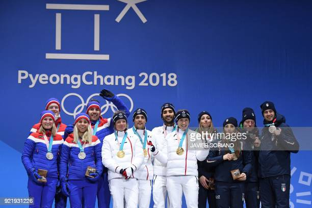 Norway's silver medallists Marte Olsbu Tiril Eckhoff Johannes Thingnes Boe and Emil Hegle Svendsen France's gold medallists Marie Dorin Habert Anais...