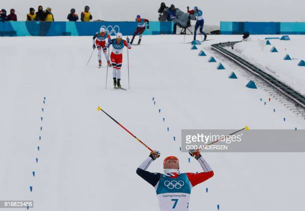 TOPSHOT Norway's Simen Hegstad Krueger crosses the line to win gold followed by Norway's Martin Johnsrud Sundby and Norway's Hans Christer Holund at...