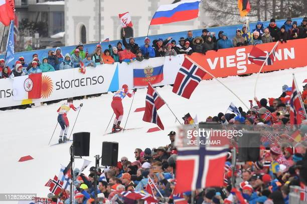Norway's Sjur Roethe and Russia's Alexander Bolshunov compete in the Men's cross country skiing relay 4x10km event at the FIS Nordic World Ski...