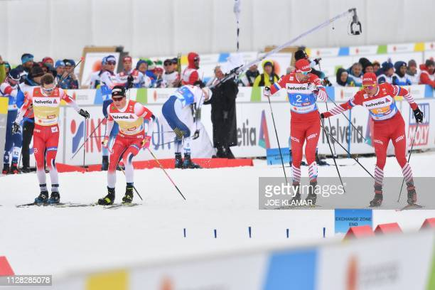 Norway's Sjur Roethe Norway's Johannes Hoesflot Klaebo Russia's Sergey Ustiugov and Russia's Alexander Bolshunov perform in the third pass over...