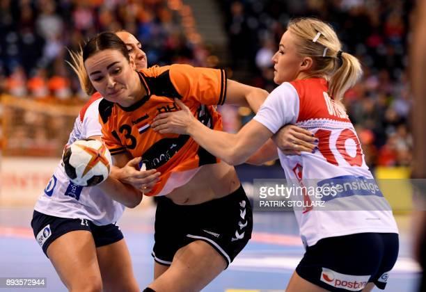 Norway´s Stine Bredal Oftedal blocks Netherlands' Yvette Broch during the IHF Womens World Championship handball halffinal match between Norway and...