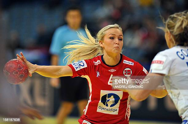 Norway's Stine Bredal Oftedal fights for the ball with France's Julie Goiorani on December 10, 2012 during a women's EHF Euro 2012 Handball...