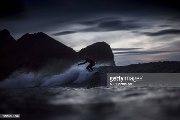 Norway's Sturla Fagerhaug rides a wave during a night session of the Lofoten Masters 2017 the world's most northerly surf competition in Unstad's bay...