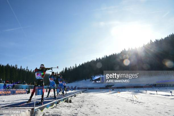 Norway's Sturla Holm Laegreid, France's Antonin Guigonnat and Italy's Didier Bionaz compete at the shooting range in the Men's 4x7,5 km Relay event...