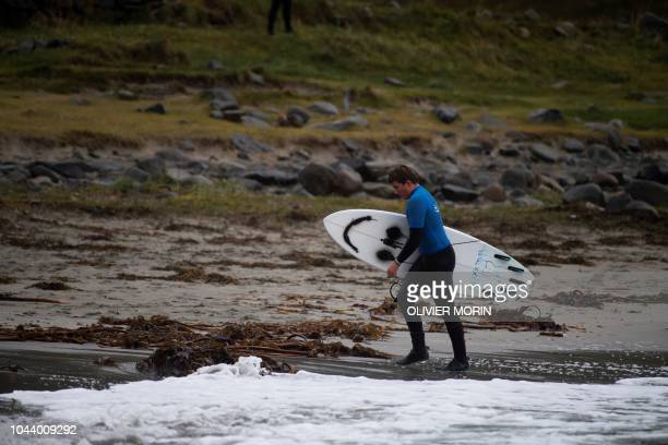 Norway's surfer Anker Frentzen Olsen walks after her session on September 27 2018 in Unstad northern Norway on the first day of the Lofoten Masters...