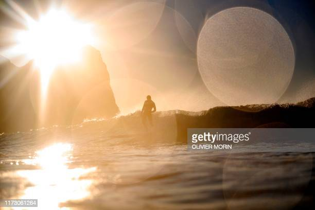 TOPSHOT Norway's surfer Anker Olsen Frantzen 18 rides a wave in Unstad Lofoten Islands beyond the Arctic Circle on September 26 during the Longboard...
