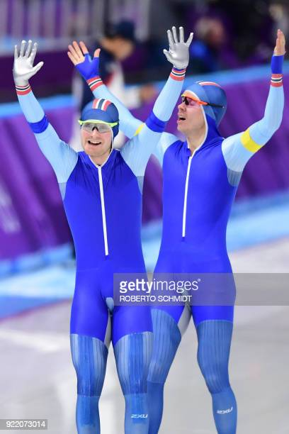 Norway's Sverre Lunde Pedersen and Norway's Simen Spieler Nilsen celebrate after winning gold in the men's team pursuit final A speed skating event...