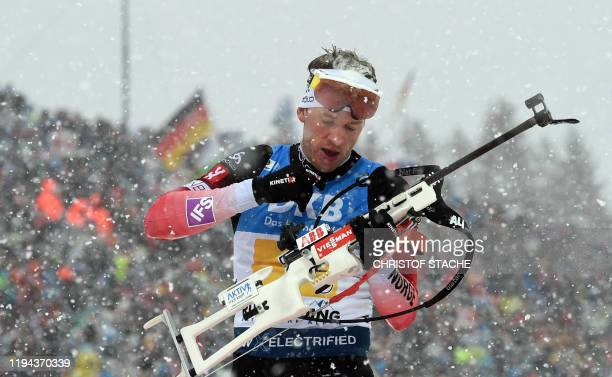 Norway's Tarjei Boe prepares his gun at the shooting range during the men's 4x75km relay event of the IBU Biathlon World Cup in Ruhpolding southern...