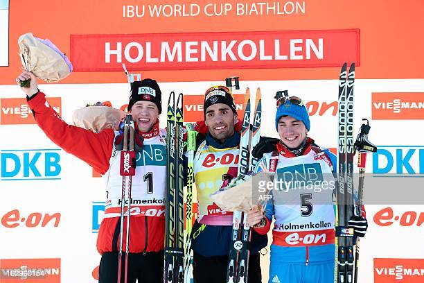 Norway`s Tarjei Boe second placed France's winner Martin Fourcade and Russia's Alexandr Loginov third placed pose for photographers after the men's...